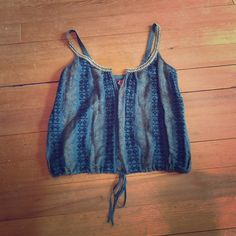 Free People bohemian embellished crop tank ✌️ Embellished cropped tank top by Free People. I believe it's part of their FP One collection. Dark teal gauzy material with stripes of a mustard yellow floral print and a dark blue embroidered diamond pattern. Straps are embellished with a woven pattern & beads. Bottom has a cute drawstring for a bubble hem fit. Hook & eye closure at top of the neckline. Size 2 but could fit a 4 also. Perfect festival top! Excellent condition. One minor flaw in…
