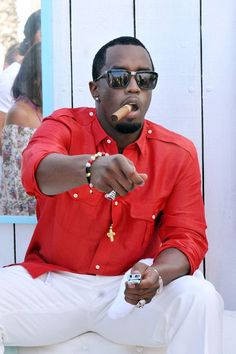 Gold Chain Men Outfit P. Diddy fashion The attire: Red, white, Cigar. Gold chain and of course. more jewlelry ; Famous Cigars, Smoking Celebrities, Sean Combs, Puff Daddy, Cigar Smoking, Men Smoking, Good Cigars, How To Pose, Height And Weight