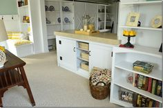 DIY coastal cottage family room | I love this site. In the cabinet, in this picture with the baskets in front, it holds her craft stuff and sewing machine. She also gives a tutorial on how to make the cabinet doors into barn style doors. I also love the big barn-style doors in background!