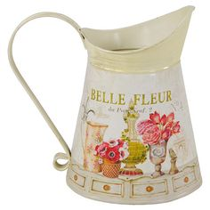A charming addition to your country kitchen or console table, this stunning tin jug features a colourful flower motif and classic design. Perfect for display...