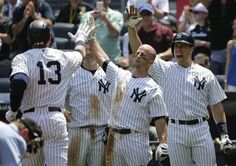 New York Yankees designated hitter Alex Rodriguez (13) is greeted by Brett Gardner, Mark Teixeira and Chase Headley after hitting a three-run home run against the Kansas City Royals during the third inning of a baseball game, Wednesday, May 27, 2015, in New York. -  (AP Photo/Julie Jacobson)