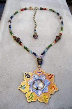 Chakra Necklace, 7 Chakra Pendant, Stone, Chakra Symbols, Lotus Flower, Energy Healing, Mandala, Chakra Jewelry. $290.00, via Etsy.