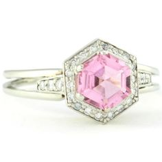 Platinum estate engagement ring with pink topaze and diamonds
