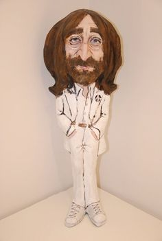 John Lennon Handmade Sculpture  This figure is dressed as in Abbey Road album.  Its handmade and handpainted.  *Size: aprox. 50 cm   Please,