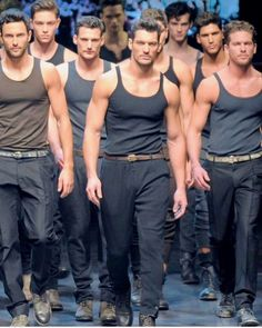 David James Gandy on the catwalk with other buff models.