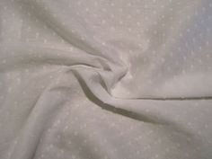 White on White Pure Cotton Dotted Swiss Fabric--One Yard. $11.95, via Etsy.