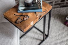 Made from upcycled and responsibly-sourced Indonesian Teak, our Natura C Table is signature Style In Form style. The minimalist modern design features a live-edge top and industrial metal base. The perfect multi tasker, it can be used as a tray table or nestled under the side of a sofa creating a handy perch for snacks, books and so much more.