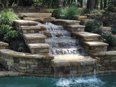 Custom Swimming Pool and Outdoor Living Space by Georgia Classic Pool    Back wall/spa?
