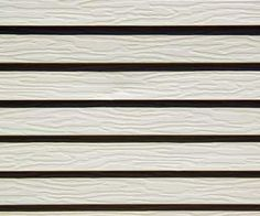 Make your own solution to clean the vinyl siding on your house.