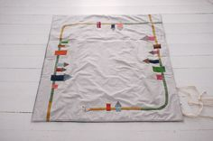 Make a playmat for Cole with roads and trees for little wooden cars.