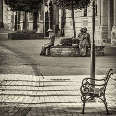 poets and the bench - Walowa street - the old town of Tarnow - Poland Polish poets: Zbigniew Herbert, Agnieszka Osiecka and Jan Brzechwa.  They are siting on another bench in the background ...