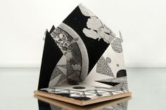 'Cosmicarium Monochrome Accordion Book'. By Peter D. Gerakaris. Approx. 20x10x10inches. Gouache, pen, ink, and intaglio on paper and wood.