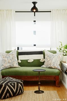 Green Settee With Striped Throw