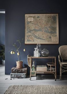 Love this moody paint color and natural accents. Gravity Home: Tiny Blue Stockholm Apartment