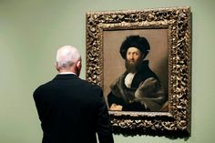 Visitor looking at the Portrait of Baldassare Castiglione by Raphael
