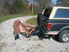 4WD Plow Blade by Ozarks Tom -- Homemade 4WD plow blade mounted by means of a 3-point hitch and powered by an electric winch. http://www.homemadetools.net/homemade-4wd-plow-blade