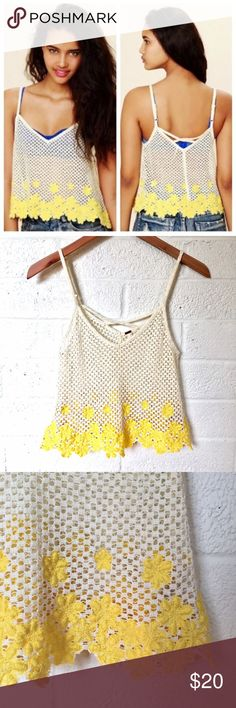 Free People Crochet Flower Festival Tank Top This pretty little ditty is PERFECT for festival season!! White crochet top with yellow embroidered flowers. Adjustable straps that have a little tiny bit of wear on the metal parts. Top is in great condition. Ready for you to frolic and have amazing carefree time! Free People Tops Tank Tops