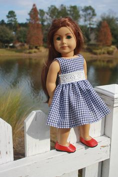 Dark Navy & White Gingham Dress, eyelet lace waist detail, Velcro closure. * All seams are serged for a clean, professional finish * Fits 18 inch dolls, including American Girl ® * Doll & shoes not included * Smoke/Pet home