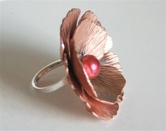 Awesome Statement Ring!  This giant poppy is made from copper and silver. The two layers of petals are cut, textured and formed by hand. In the
