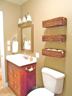 Bathroom organization... Baskets nailed right to wall!