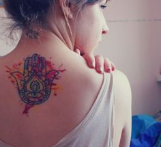 This spiritual Hamsa hand tattoos has creative watercolor splatters to add visual appeal « « Ratta Tattoo