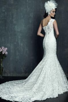 Gorgeous, lace, trumpet style, one shoulder, wedding gown from Allure Bridal. Back view