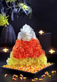 Candy corn flowers make for a fun Halloween centerpiece! Floral Expert Julie Mulligan shows you how to create this fun and festive Halloween candy corn floral arrangement Halloween Flowers, Halloween Candy, Holidays Halloween, Happy Halloween, Halloween Decorations, Halloween Centerpieces, Halloween Stuff, Halloween Ideas, Carnation Centerpieces