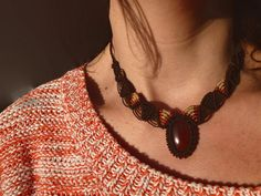 This macramé choker necklace is a lovely individual piece, its not too big but the intricate knotting and deep carnelian will draw attention.