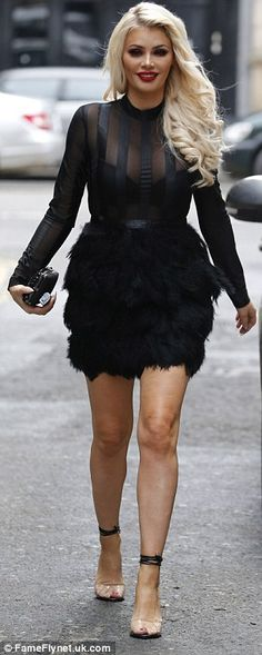 Her pins looked incredible in a feathery black skirt as she strutted her stuff on set...