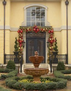 Christmas front door design with natural greenery and large ornaments