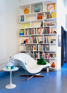 white eames chair and tulip side table