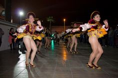 Caporales girls shaking what they've got - love those sparkly gold panties!!