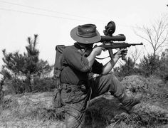 An Australian soldier takes aim with his M2 Carbine during the Korean war.