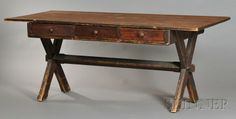 Early sawbuck table with original finish and three drawers. www.skinnerinc.com