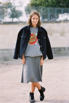 graphic sweatshirt with matching midi skirt, flat booties, & jacket