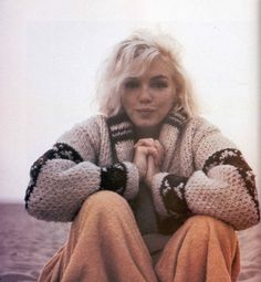 Marilyn photographed by George Barris 1962 it's said to be the last photo of Marilyn before she died. But I think it was Dodger Stadium.