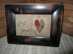 Primitive Stitched Sampler - live simply - quilt heart - black frame