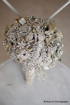 Brooch bouquet--because I hate flower bouquets and the bouquet toss is tacky. I can keep this one forever!