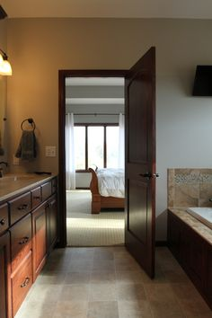 Interior Doors | A Master Bedroom With A Two Panel, Arched, Poplar Door  That Leads Into A Gracious Master Bathroom | Bayer Built Woodworks, Inc. |  Pinterest ...