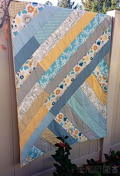 Simplicity can be attractive, and this quilt is proof!  Jen Allyson of The Project Girl created this excellent tutorial to walk us through the steps of creating a diagonal strip quilt.  Quilts like these are fast and easy to create, and as you can see, the results are beautiful!  http://www.freequiltpatterns.info/free-tutorial---diagonal-strip-quilt-by-jen-allyson.htm