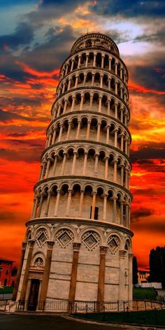 The Leaning Tower of Pisa in Italy, looking magical at dusk.