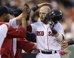 Boston Red Sox's Dustin Pedroia is congratulated by teammates after his two-run home run off Toronto Blue Jays starting pitcher Chien-Ming Wang during the second inning of a baseball game at Fenway Park, Thursday, June in Boston. In Boston, Boston Red Sox, 2013 World Series, Dustin Pedroia, Fenway Park, Toronto Blue Jays, Baseball Games, High Five, Motorcycle Jacket