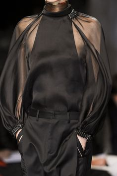 Givenchy Spring 2013 (Raglan Sleeve) This style of sleeve has gained popularity in recent years. With cut outs becoming popular again, adding sheer raglan sleeves is a more modest way to show skin while still maintaining modesty.