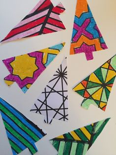 Cut simple tree shapes from patterned colouring books and doodle! We used i oil pastels for these - great for banners and card making for kids