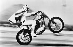 Evel Knievel pulling a wheelie on his epic Harley-Davidson XR-750 stunt motorcycle of steel, alloy, and fiberglass that weighed-in at about ...