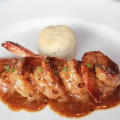 Emeril's New Orleans Barbecue Shrimp -- This dish takes shrimp and grits to a whole new level. With an amazingly rich barbecue base that is buttery and delicious, these shrimp are still one of the most popular dishes at Emeril's and they will n Fish Recipes, Seafood Recipes, Cooking Recipes, Cooking Corn, Cooking Turkey, Pork Recipes, Yummy Recipes, Barbeque Shrimp, Seafood Bbq