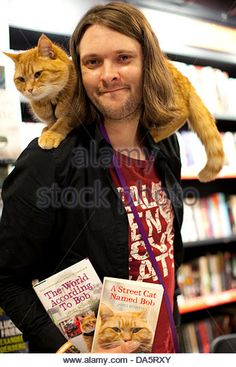 London, UK. 04th July, 2013. Busker James Bowen and his Street Cat Named Bob launched their third book this evening - Stock Photo