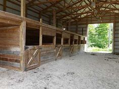 85 Acres Corp retreat/Horse Farm - I like the simplicity of the stalls. I would make sure the horses could not get to each other over the sides of the stalls. Barn Stalls, Horse Stalls, Simple Horse Barns, Barn Layout, Cattle Barn, Shed Floor Plans, Horse Shelter, Horse Barn Plans, Goat Barn