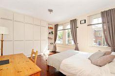 Cupboards across main bedroom wall