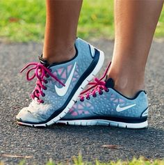 Nike pink, black, and gray with white sneakers